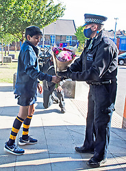 ©Licensed to London News Pictures 26/09/2020  <br /> Croydon, UK. A young rugby player with flowers for Sgt Matt Ratana at Croydon Custody Centre this morning. A murder investigation has been launched by police after the death of  custody police sergeant Matt Ratana at the Croydon Custody Centre in South London yesterday.Photo credit:Grant Falvey/LNP