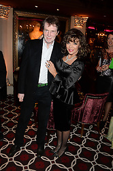 JOAN COLLINS and her brother BILL COLLINS at a party to celebrate the publication of 'Passion for Life' by Joan Collins held at No41 The Westbury Hotel, Mayfair, London on21st October 2013.