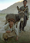 Our love of trekking with donkeys is irresistible: we decide to tackle the next 300Km through the Little Pamir and into Pakistan with this donkey as a companion. After much aimeless walk through Qala-i-panjah, we spot one that looks smart enough to join our husband-wife team - a pretty long legged, long eared donkey. Price: 150US$, Matriculate: Donkey G. <br /> <br /> Adventure through the Afghan Pamir mountains, among the Afghan Kyrgyz and into Pakistan's Karakoram mountains. July/August 2005. Afghanistan / Pakistan.