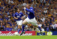 Photo: Greig Cowie.<br /> 23/08/2003.<br /> FA Barclaycard Premiership. Everton v Fulham. Goodison Park.<br /> Wayne Rooney bursts up the middle