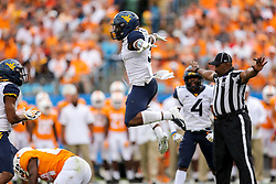 Sep 1, 2018; Charlotte, NC, USA; West Virginia Mountaineers safety Toyous Avery (3) celebrates after a play during the third quarter against the Tennessee Volunteers at Bank of America Stadium. Mandatory Credit: Ben Queen-USA TODAY Sports