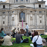 Members of the Christian Climate Action group meet to pray near Parliament in central London during protests urging the government to take urgent action on climate change.