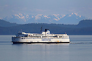 The BC Ferries vessel Queen of Nanaimo crosses the Strait of Georgia between mainland Canada and Vancouver Island. The Olympic Mountains of Washington state are in the background. BC Ferries, the common name for British Columbia Ferry Services Inc., is the largest passenger ferry system in North America and the second-largest in the world. It is a Crown corporation, owned by the Canadian government.