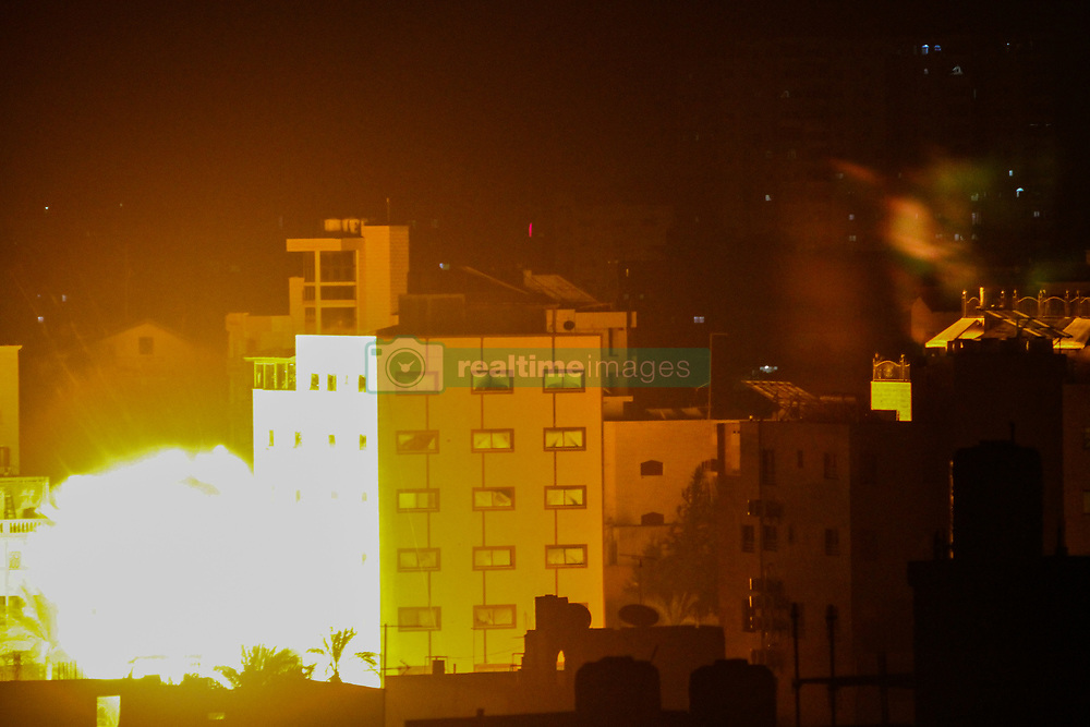 May 4, 2019 - Israeli aircrafts bomb the Sarraj residential building on the west of Gaza City. The airstrike takes place as Israel continue its aerial offensive on the Gaza Strip. This Saturday's ongoing airstrikes by the Israeli Defence Forces have been targeting military sites but also civilian buildings in different areas of the Gaza Strip (Credit Image: © Ahmad Hasaballah/IMAGESLIVE via ZUMA Wire)