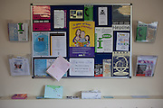 A noticeboard and leaflets available in the visitors centre. HMP Styal, Wilmslow, Cheshire