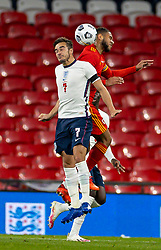 LONDON, ENGLAND - Thursday, October 8, 2020: Wales' Tyler Roberts (R) challenges for a header with England's Harry Winks (L) during the International Friendly match between England and Wales at Wembley Stadium. The game was played behind closed doors due to the UK Government's social distancing laws prohibiting supporters from attending events inside stadiums as a result of the Coronavirus Pandemic. England won 3-0. (Pic by David Rawcliffe/Propaganda)