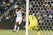Los Angeles Galaxy defender Omar Gonzalez wins the ball from Columbus Crew defender Chad Marshall inside the box during the first half of an MLS soccer match Saturday, Sept. 11, 2010, in Carson, Calif. The Galaxy won 3-1. (AP Photo/ Bret Hartman)