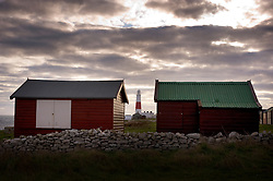 Portland Bill lighthouse and beach sheds, Isle of Portland, Dorset, England, UK.
