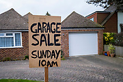 A sign reading 'Garage Sale Sunday 10am' appears in the front garden of a bungalow in front of the garage on the 14th of February 2020 on Bathurst road in Folkestone, United Kingdom.  A garage sale is a common informal sale of used goods by a private individual normally held in their garage and front garden. (photo by Andrew Aitchison / In pictures via Getty Images)