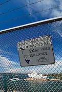 Sign on Sydney Harbour Bridge footpath, Sydney Opera House in background. Sydney, Australia