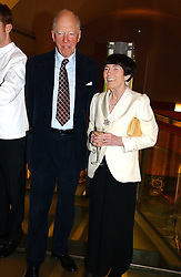 LORD & LADY ROTHSCHILD at the opening reception of 'Bejewelled by Tiffany 1837-1987' at The Gilbert Collection, Somerset House, London on 21st June 2006.