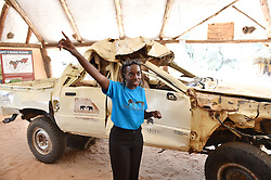 """Resson from Save the Elephants introduces their work in front of a truck destroyed by emotionally instable elephants during mating season, at STE camp in Samburu National Reserve, Kenya, March 1, 2016. In northern Kenya's Samburu region, there lives the second largest group of elephant species in this country. Around them, a number of elephant defenders have watched them day and night for the past 18 years. Founded in 1993, the organization Save The Elephants (STE) has been devoting its attention to secure the future of elephants and battle the ivory poaching. The World Wildlife Day is observed on March 3 with """"The future of wildlife is in our hands"""" being the theme and """"The future of elephants is in our hands"""" being the subtopic this year. EXPA Pictures © 2016, PhotoCredit: EXPA/ Photoshot/ Sun Ruibo<br /><br />*****ATTENTION - for AUT, SLO, CRO, SRB, BIH, MAZ only*****"""