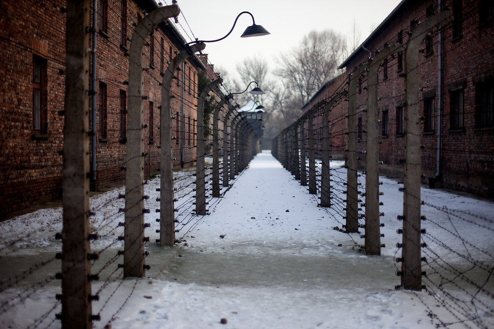 A barbed wire fence surrounds the Auschwitz Nazi concentration camp. It is estimated that between 1.1 and 1.5 million Jews, Poles, Roma and others were killed here during the Holocaust between 1940-1945. 27 January 2015 is the 70th anniversary of the liberation of Auschwitz-Birkenau.