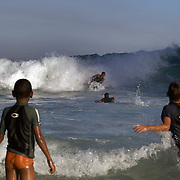Local youngsters take surf lessons at Sao Conrado beach, Rio de Janeiro,  Brazil. 8th July 2010. Photo Tim Clayton..