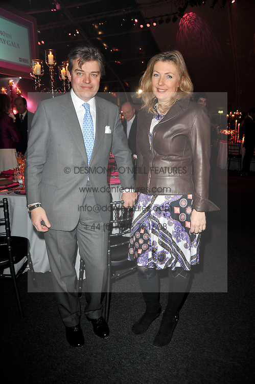 The EARL & COUNTESS OF CARNARVON at the KIDS 40th Birthday Gala Dinner held in the Boiler House at Battersea Power Station, London on 10th March 2011.