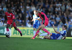 Bristol Rovers' Adam Cunnington tackles Dover Athletic's Tyrone Sterling - Photo mandatory by-line: Alex James/JMP - Mobile: 07966 386802 - 04/10/2014 - SPORT - Football - Bristol - Stoke Gifford Stadium - Bristol Academy Womens v Notts County Ladies - Womens Super League
