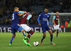 Cheikhou Kouyate of West Ham United in action against Gokhan Inler (L) and Riyad Mahrez (R) of Leicester City  - Mandatory byline: Jack Phillips/JMP - 07966386802 - 22/09/2015 - SPORT - FOOTBALL - Leicester - King Power Stadium - Leicester City v West Ham United - Capital One Cup Round 3