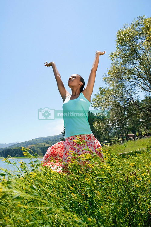 Aug. 23, 2012 - Woman stretching her arms (Credit Image: © Image Source/ZUMAPRESS.com)