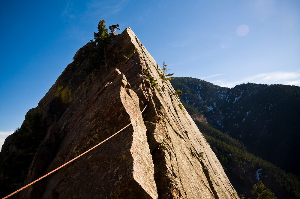 Nathan Kurz stands on the summit of Tower One on Redgarden Wall, Eldorado State Park, Colorado.