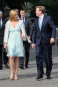The Dutch prince Willem-Alexander (R) and his wife princess Maxima walk in front of Castle Duivenvoorde in Voorschoten, The Netherlands on 28 April 2010. The royal couple opened the exhibit Tijdloos Trendy (Forever Trendy). The exhibit is one of the activities of the 50th anniversary of the Duivenvoorde foundation. <br />