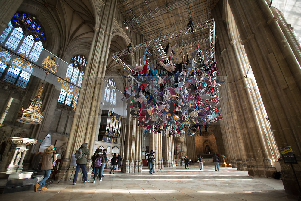 """@Licensed to London News Pictures 22/02/2018. Canterbury, UK. Artist Arabella Dorman installation called """"Suspended"""" opens to the public tomorrow 23rd February 2018 in the nave of Canterbury Cathedral in Kent. This evocative artwork highlights the plight of refugees around the world and is made up of hundreds of items of refugee clothing found mainly on the beaches of the Greek Island of Lesbos. Photo credit: Manu Palomeque/LNP"""
