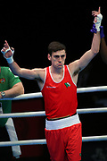 Aidan Walsh of Ireland (red) celebrates beating Pavel Kamanin of Estonia (not pictured) during The Road to Tokyo European Olympic Boxing Qualification, Sunday, March 15, 2020, in London, United Kingdom. (Mitchell Gunn-ESPA-Images/Image of Sport)