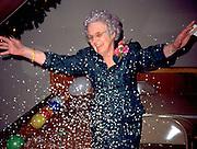 Grandmother age 82 celebrating with glitter at wedding reception.  St Peter  Minnesota USA