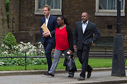 © London News Pictures. 22/05/15. London, UK. From L to R: TV presenter and adventurer Ben Fogle is joined by Sabrina Jean and Gianny Augustin, exiles of the Chagos Islands, to hand in a petition at 10 Downing Street calling for the islanders to be allowed to resettle on the islands, Westminster, Central London. Photo credit: Laura Lean/LNP