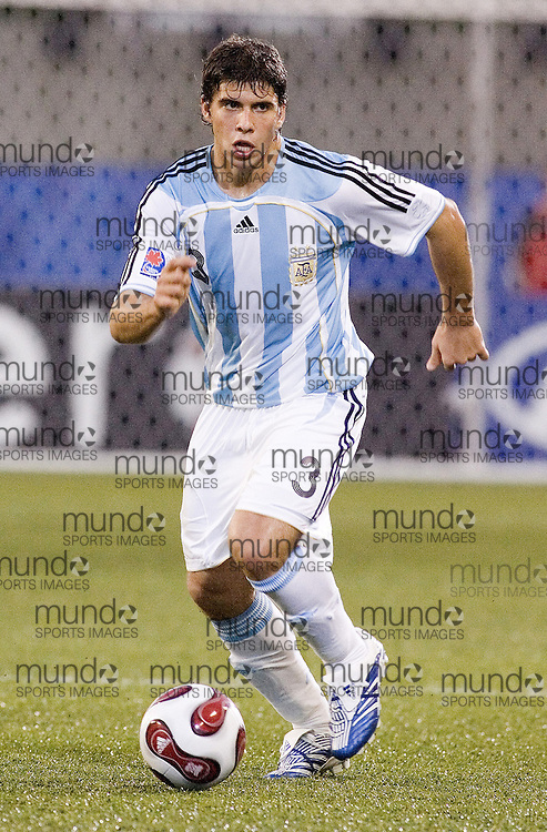 30 June 2007 (Ottawa) -- The Czech Republic (CZE) versus Argentina (ARG) group stage game in the FIFA U-20 World Cup Canada 2007. The game ended with a 0-0 draw...Emiliano Insua of Argentina...Photo credit Sean Burges/Mundo Sport Images.