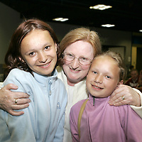 Mary Hogan, Tulla Co.Clare gives a big Hug to sistersYulia and Galina Veronich  after Youlia and Galina arrived from Chernobyl  into Shannon Airport to stay with the Hogan Family in Tulla Co.Clare.<br /> Pic.Brian Gavin/Press 22