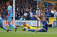 AFC Wimbledon midfielder Scott Wagstaff (7) appealing for a penalty during the EFL Sky Bet League 1 match between AFC Wimbledon and Coventry City at the Cherry Red Records Stadium, Kingston, England on 11 August 2018.