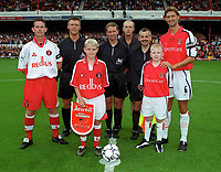 The two captains (Tony Adams - Arsenal and Mark Kinsella - Charlton) line up before the match. Arsenal v Charlton Athletic, 26/8/00. Credit: Colorsport / Andrew Cowie.