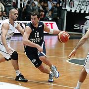 Anadolu Efes's Kerem Tunceri (C) during their Turkish Basketball league derby match Besiktas between Anadolu Efes at the BJK Akatlar Arena in Istanbul Turkey on Saturday 31 December 2011. Photo by TURKPIX