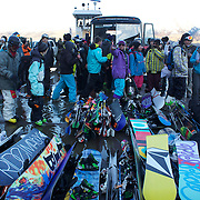 Competitors stack their snowboards and ski's on a barge on Lake Wanaka before competition during the World Heli Challenge Extreme Day at Mount Albert on Minaret Station, Wanaka, New Zealand. 1st August 2011