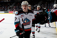 KELOWNA, BC - FEBRUARY 17: Jonas Peterek #27 of the Kelowna Rockets celebrates a goal with fist bumps by the bench against the Calgary Hitmen at Prospera Place on February 17, 2020 in Kelowna, Canada. (Photo by Marissa Baecker/Shoot the Breeze)