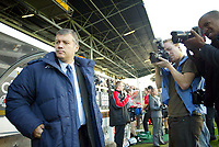 30/10/2004<br />FA Barclays Premiership - Fulham v Tottenham Hotspur - Craven Cottage, London<br />Tottenham Hotspur manager Jacques Santini stands in the away dugout infront of press photographers before the game.<br />Photo:Jed Leicester/Back Page Images