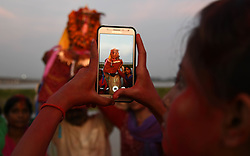 September 1, 2017 - Allahabad, Uttar Pradesh, India - Allahabad: An Indian hindu devotee take photos from her mobile during immersion of Lord Ganesha's idol in River Ganga during Ganesh Chaturthi festival celebration in allahabad on 01-09-2017. (Credit Image: © Prabhat Kumar Verma via ZUMA Wire)