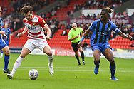 John Marquis of Doncaster Rovers (9) looks to make space to shoot under close attention from Gabriel Zakuani of Gillingham (6) during the EFL Sky Bet League 1 match between Doncaster Rovers and Gillingham at the Keepmoat Stadium, Doncaster, England on 20 October 2018.