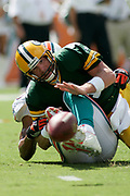 Green Bay Packers quarterback Brett Favre fumbles after he his hit by Miami Dolphins defensive lineman Jason Taylor during the Packers 34-24 victory over the Dolphins on October 22, 2006 at Dolphin Stadium in Miami, Florida.