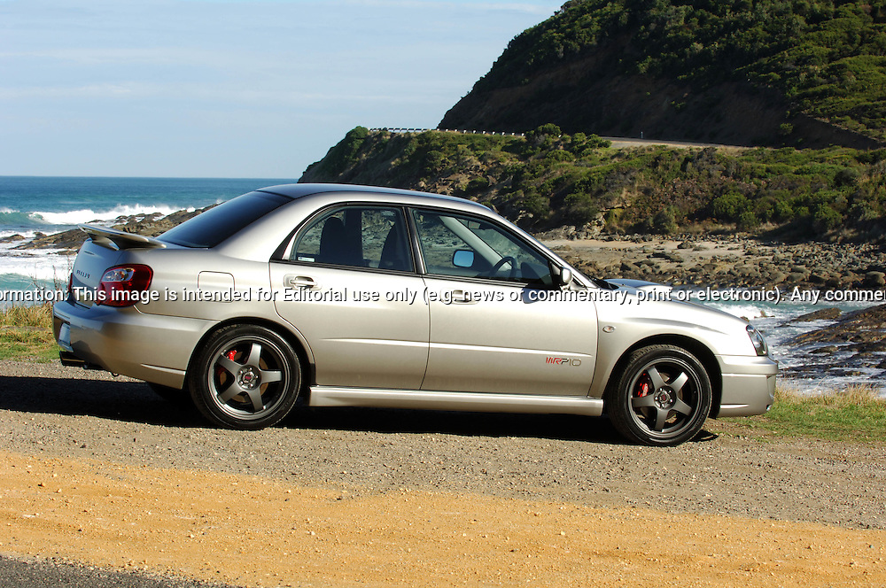 """Subaru Impreza WRX WRP10 - a limited edition model exclusive to the Australian market. .The WRP10 was available from late January 2005 and was limited to 200 units, featuring individually numbered badges..The model name comes from Subaru's heritage, the """"WR"""" represents Impreza WRX's success in World Rally competition, """"P"""" the enormous rallying contribution from Pirelli tyres and """"10"""" the years since launch of the original Impreza WRX""""..Available exclusively in Crystal Grey Metallic manual sedan, the WRP10 includes a STI engine performance upgrade kit increasing peak power from standard WRX's 168 kW @ 6,000 rpm to175kW @ 6,000 rpm..The kit includes a replacement Electronic Control Unit, upgraded exhaust components and a unique large single tip muffler..A carbon fibre strut brace and WRX suspension lowering kit, with stiffer springs drop the car's ride height by 15mm..WRP10 is finished off with high performance, lightweight five-spoke forged alloy RAYS wheels and Pirelli P Zero Nero tyres (215 45Z R 17 91Y)..The limited edition model was the first developed by STI Australia, in conjunction with STI Japan .(C) Joel Strickland Photographics.Use information: This image is intended for Editorial use only (e.g. news or commentary, print or electronic). Any commercial or promotional use requires additional clearance."""