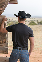 back of a hot cowboy outdoors