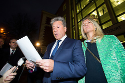 © Licensed to London News Pictures. 14/12/2015. London, UK. Radio DJ NEIL FOX, aka Dr Fox, reading a statement as he leaves Westminster Magistrates Court in London with his wife VICKY FOX, where he was found not guilty on 10 separate charges of indecent assault and sexual assault. Photo credit: Ben Cawthra/LNP