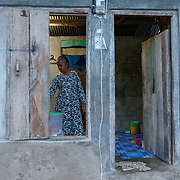 Looking into the small home of a local woman in the village of Komodo. Komodo Island, Indonesia.
