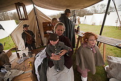 © London News Pictures. 08/04/2012. South Okendon, UK.  Members of the Southern Skirmish Association dressed as Confederate soldiers and their families relax at camp before taking part in a reenactment of the final days of the American Cival war at Belhus Wood Country Park near South Okenden, Essex on April 8, 2012. The American Civil war was ended on April 9 (Tomorrow), 1865 when the  Confederate surrendered to the Union. Photo credit :  Ben Cawthra/LNP