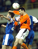 SPORTSBEAT 01494 783165<br /> PICTURE ADY KERRY .<br /> MILLWALL VS CARDIFF CITY<br /> MILLWALL'S KEVIN BRANIFF AND DANNY DICHIO  CHALLENGE CARDIFF CITY'S TONY VIDMAR DURING THEIR DIVISION 1 MATCH AT THE NEW DEN, 7TH APRIL 2004.