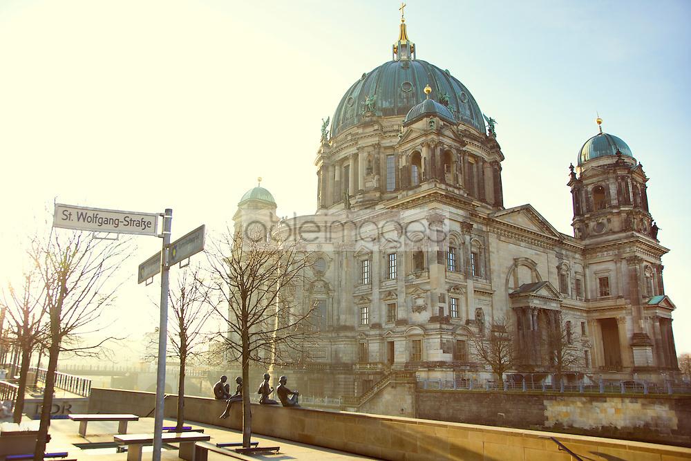 """""""Drei Mädchen und ein Knabe"""" (Three Girls and a Boy) by Wilfried Fitzenreiter, 1988, Berlin Cathedral in background"""