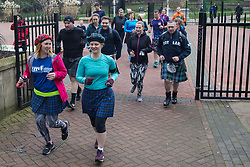London, UK. 25 January, 2020. Participants wearing kilts take part in the annual London Kilt Run for Robert Burns Day. The event starts and finishes at the statue of Robert Burns in Victoria Embankment Gardens and passes a number of Scottish-themed landmarks along the route.