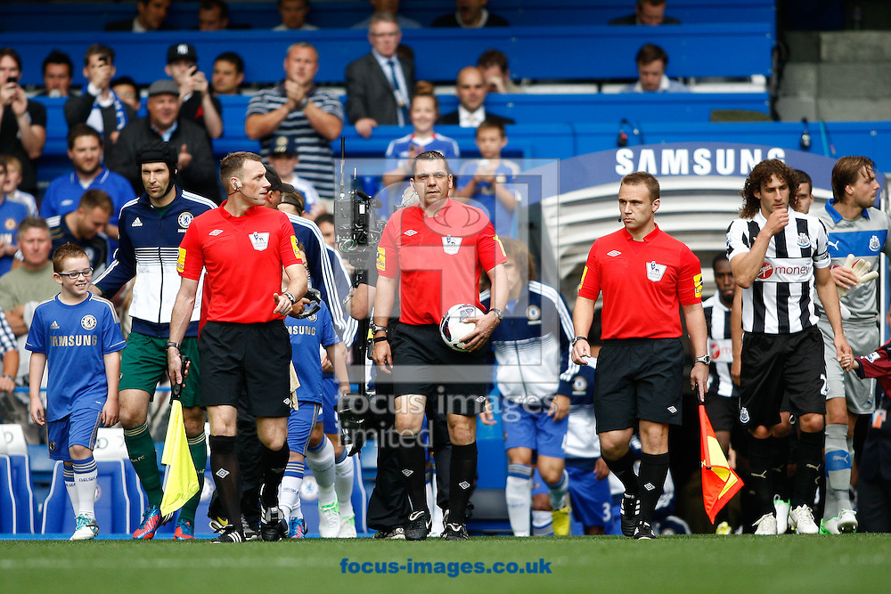 Picture by Andrew Tobin/Focus Images Ltd +44 7710 761829. 25/08/2012.  Referee Phil Dowd leads the teams onto the pitch during the Barclays Premier League match at Stamford Bridge, London.