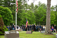 Bob O'Neill of American Legion Post 33 and Petty Officer John Dever III honor those who died in the US Armed Services during the Memorial Day service held in Oakland Cemetery Monday morning.  (Karen Bobotas/for the Laconia Daily Sun)