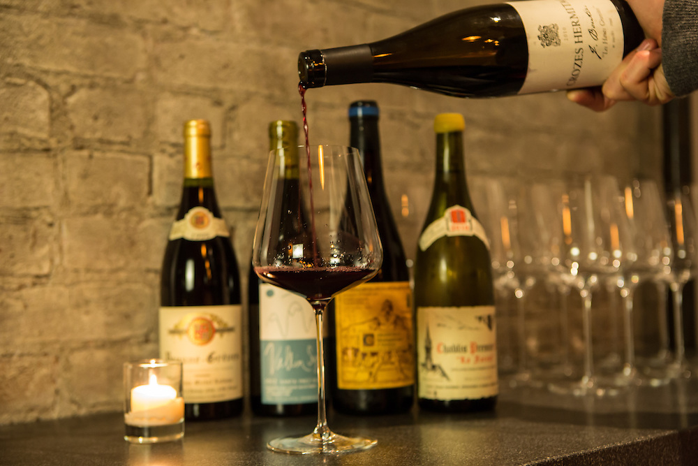New York, NY, Sept. 30, 2013. Grant Reynolds, wine director at Charlie Bird. (L to R) A Beaune-Grėves from Michel Lafarge, A Santa Ynez valley Vallin Syrah from Lieu Dit, a Valentini Montepulciano de Abruzzo, and a Vincent Dauvissat 1ere crus Chablis.